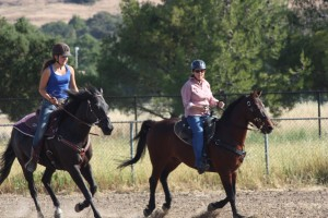 Kelsey and Linda cantering